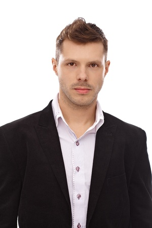 serious face: Portrait of young businessman with trendy hairstyle. Stock Photo