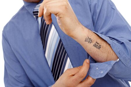 forearm: Businessman with tattoo in forearm. Body part.