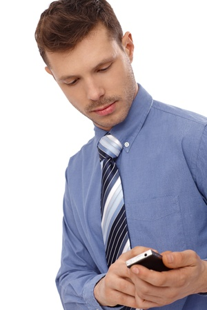 Young businessman in blue shirt using mobilephone. photo