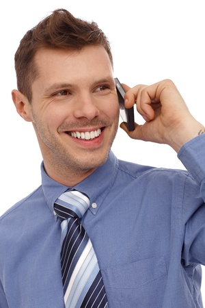 Happy young businessman talking on mobilephone, smiling. Stock Photo - 13964916