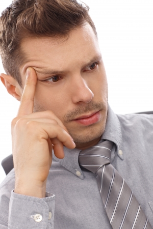 Closeup portrait of thinking young businessman. photo