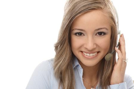 dispatcher: Closeup portrait of happy young blond dispatcher.