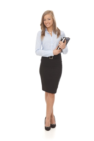 Full size photo of happy young blonde businesswoman holding personal organizer. Stock Photo