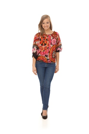 full size: Full size photo of trendy girl, smiling, wearing blouse and jeans.