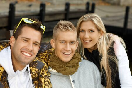 Outdoor portrait of attractive young smiling people. photo