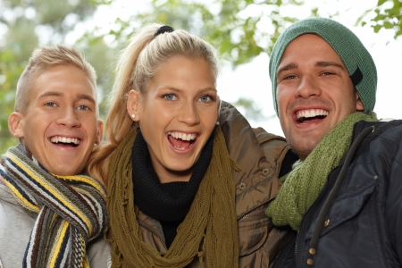Closeup portrait of attractive smiling young people outdoors. photo