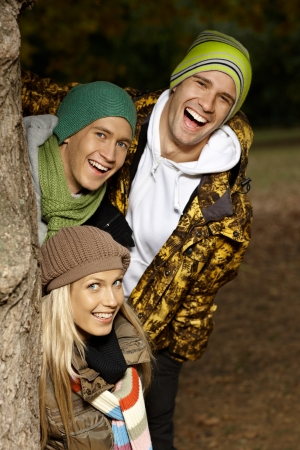 College students having fun in autumn park, smiling. photo
