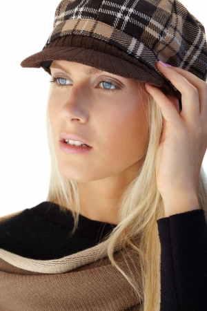 Autumn portrait of blonde beauty in trendy hat, posing, photo