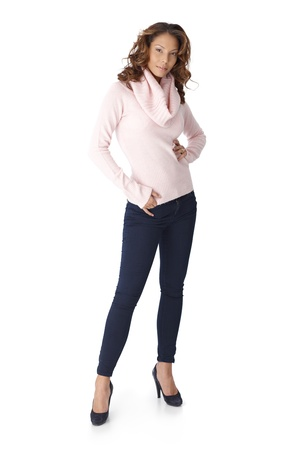 Full size photo of confident young casual woman over white background. photo