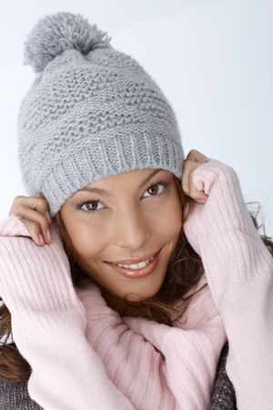 Closeup portrait of attractive winter girl, wearing hat, smiling. photo