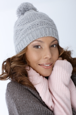 Portrait of attractive female in winter clothes smiling. photo