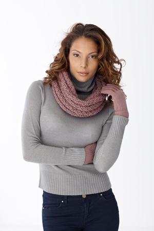 Portrait of pretty casual woman in scarf and gloves over white background. photo