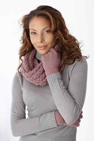 Attractive afro woman wearing scarf and gloves, smiling. photo