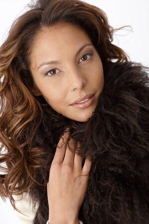 Closeup portrait of attractive female with fur around neck. photo