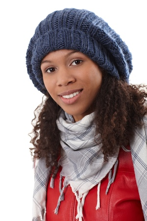 Closeup portrait of attractive ethnic woman in knitted hat, smiling. Stock Photo - 14314255