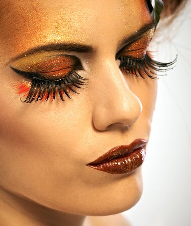 up close image: Beauty studio shot redhead woman in autumn makeup
