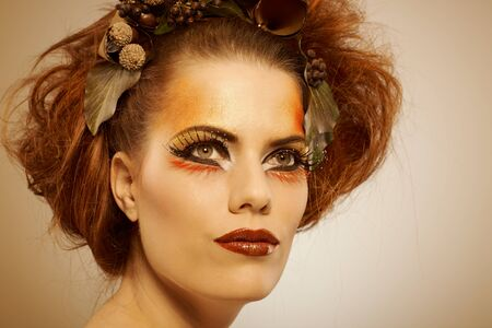 Beauty studio shot redhead woman in autumn makeup photo