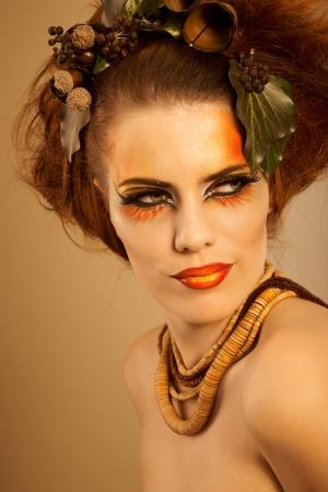 Beauty studio shot redhead woman in autumn makeup photo
