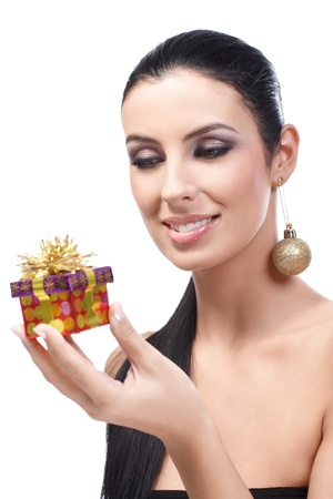 Attractive young woman receiving christmas present, smiling. photo