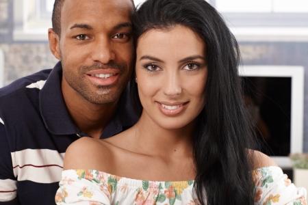 Closeup portrait of beautiful interracial couple smiling at home. photo