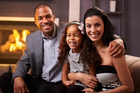 fireplace family: Portrait of happy diverse family at home, all smiling.