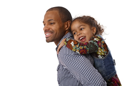 Afro father carrying cute little girl piggyback, both smiling. Stock Photo - 14427538