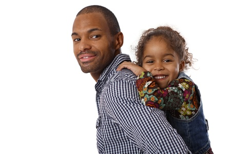 Portrait of handsome ethnic father and little girl piggyback, smiling. photo