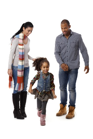 Beautiful afro little girl running, parents watching from behind. Stock Photo - 14427372
