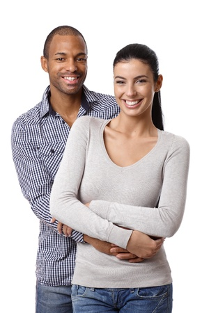 couple cuddling: Portrait of beautiful mixed race couple, embracing, smiling, looking at camera.