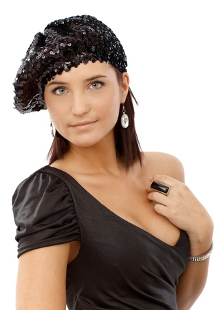 Party girl in sexy black dress and sequin hat smiling. photo