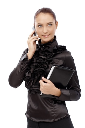 Smiling businesswoman in fancy black shirt speaking on mobile phone, holding personal organizer. Stock Photo - 14746000