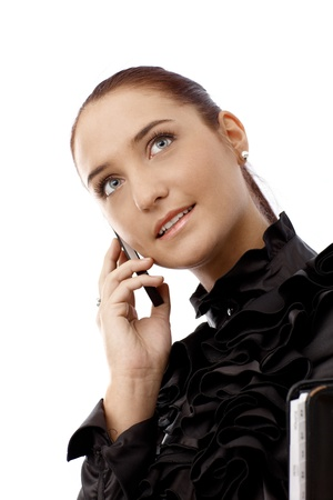 Portrait of happy businesswoman on mobile phone call, in smart black shirt, looking up. Stock Photo - 14745976