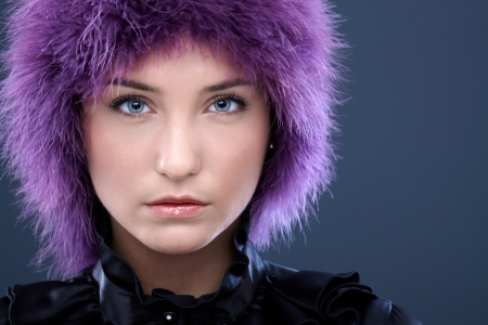 20s  closeup: Portrait of serious young woman in purple wig, looking focused, copyspace. Stock Photo