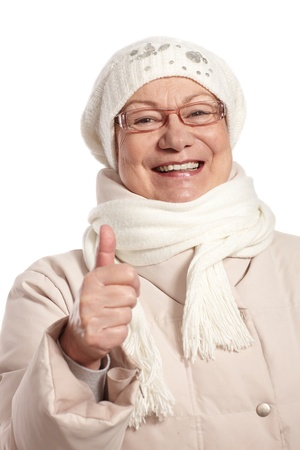 Winter portrait of happy old woman with thumb up. photo