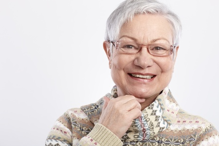 Closeup portrait of smiling elderly woman in glasses. Stock Photo