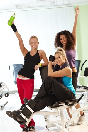 Pretty girls posing and smiling at the gym. photo