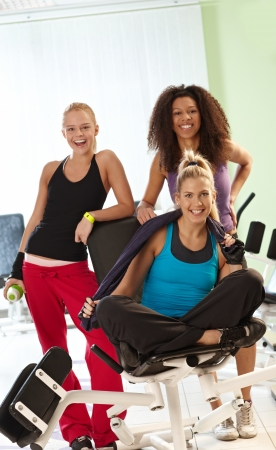 Happy women smiling at the gym, having break. photo