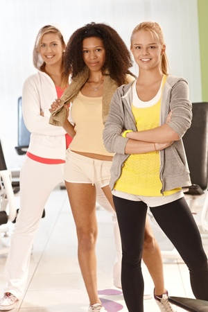 Fit girls standing and smiling at the gym. Stock Photo - 14746190