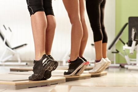 calf: Muscular female calves exercising at the gym.