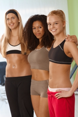 Pretty fit girls embracing at the gym. Stock Photo - 14746186