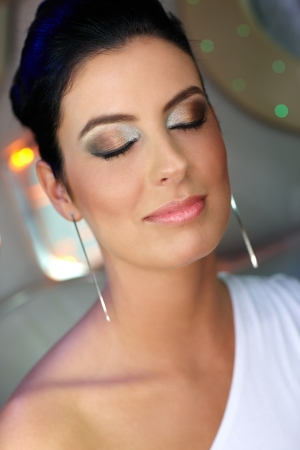 up close image: Portrait of beautiful elegant woman with make-up eyes closed. Stock Photo