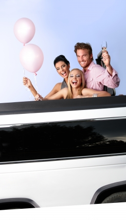 Attractive young people having party fun in limousine. photo