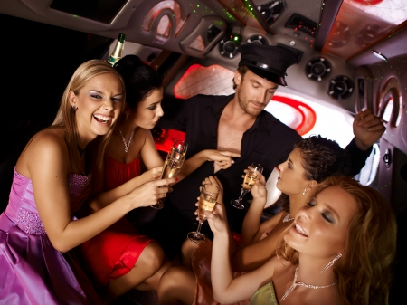 bachelorette: Hot bachelorette party party in limousine with handsome chauffeur and beautiful girls.