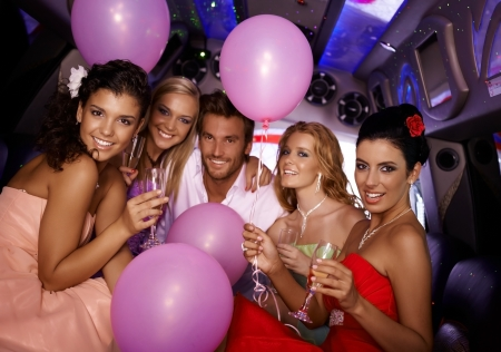 Attractive young people having party in limousine. photo
