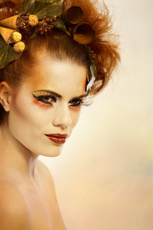 Beauty portrait redhead woman in autumn makeup photo
