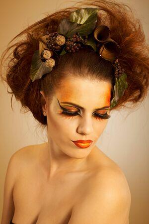 Beauty portrait redhead woman in autumn makeup photo