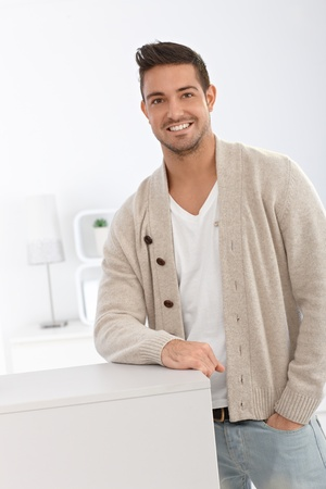 Casual young man standing and smiling at home. Stock Photo - 15032934