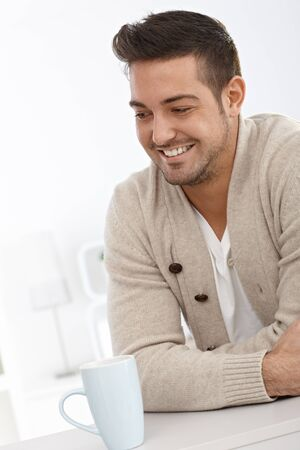 Portrait of happy young man smiling at home. Stock Photo - 15032904