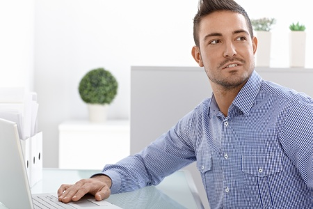 Portrait of young man using laptop computer. Stock Photo - 15033036