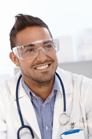 safety googles: Portrait of young doctor wearing safety googles. Stock Photo